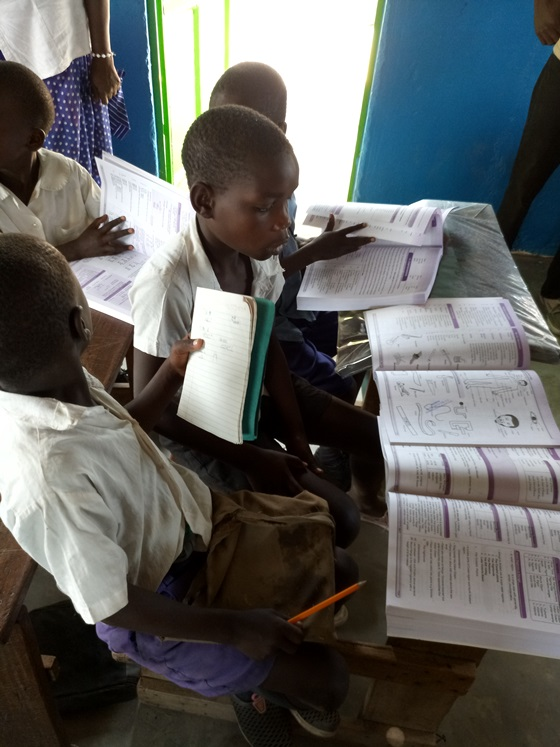 Students use the textbooks during lessons at Mbita