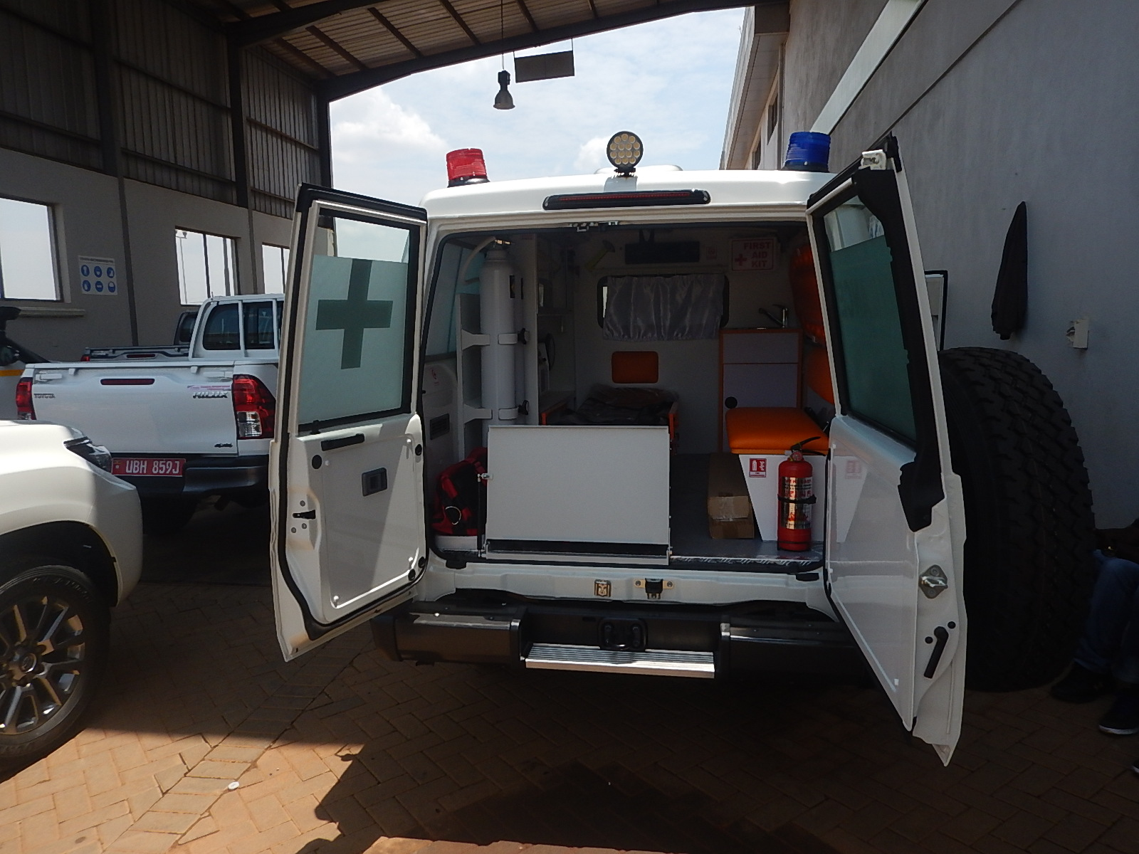 A medical ambulance with open back doors