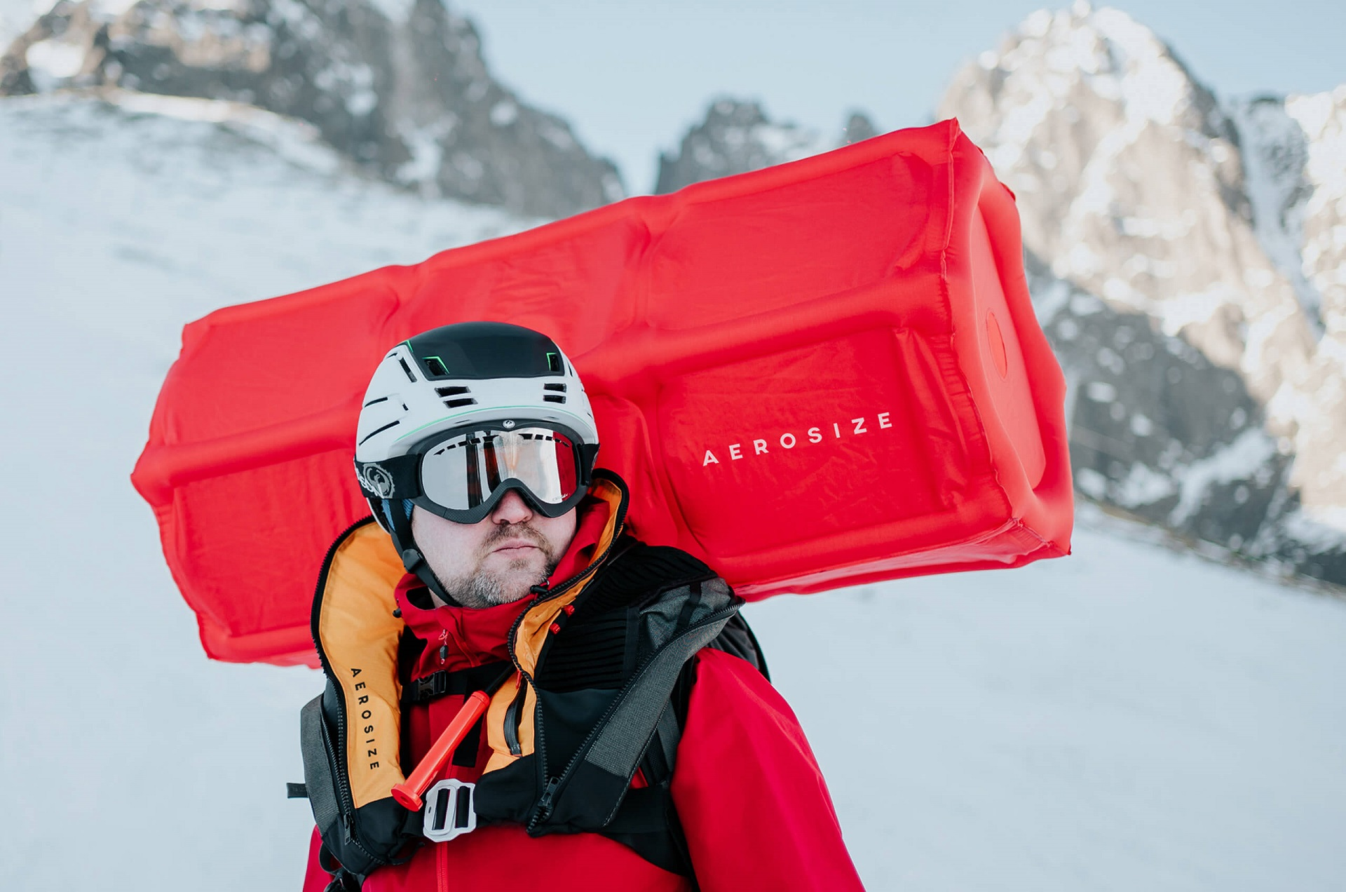 Team member Maciej Roth wearing the AEROSIZE avalanche airbag, in the mountains in winter