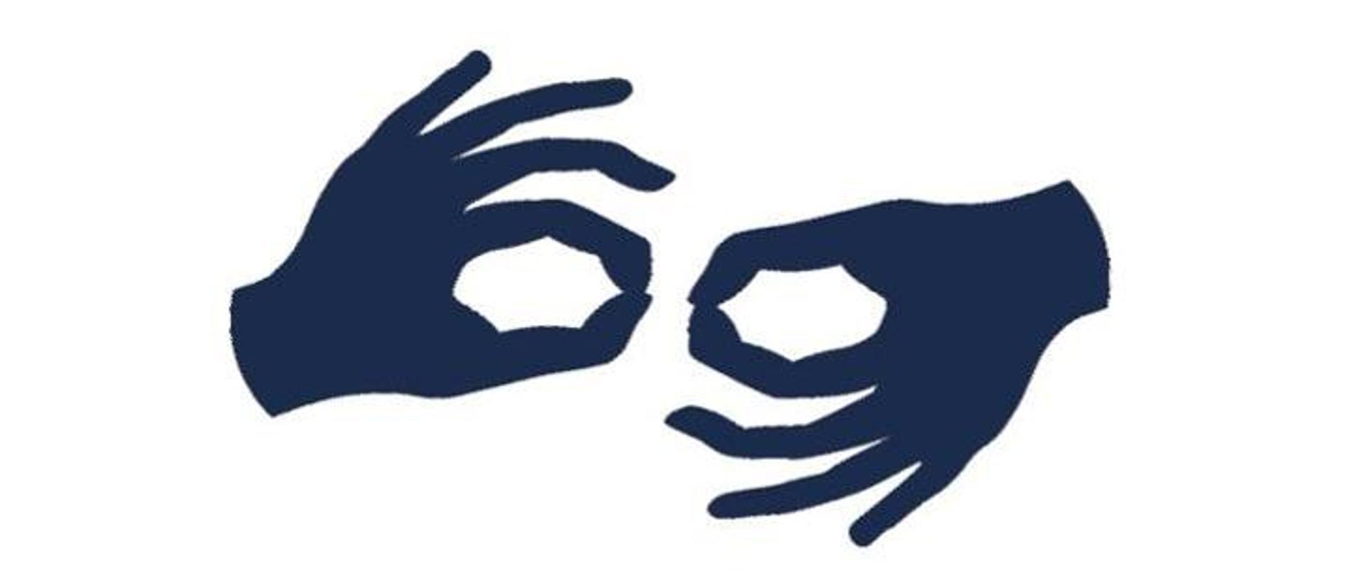 dwie dłonie w geście języka migowego