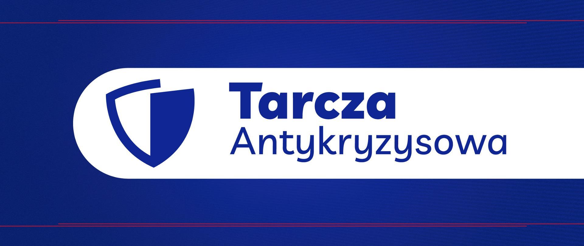 Na niebieskim tle biały pasek na którym po lewej stronie jest biało niebieska tarcza a po prawej stronie napis Tarcza Antykryzysowa