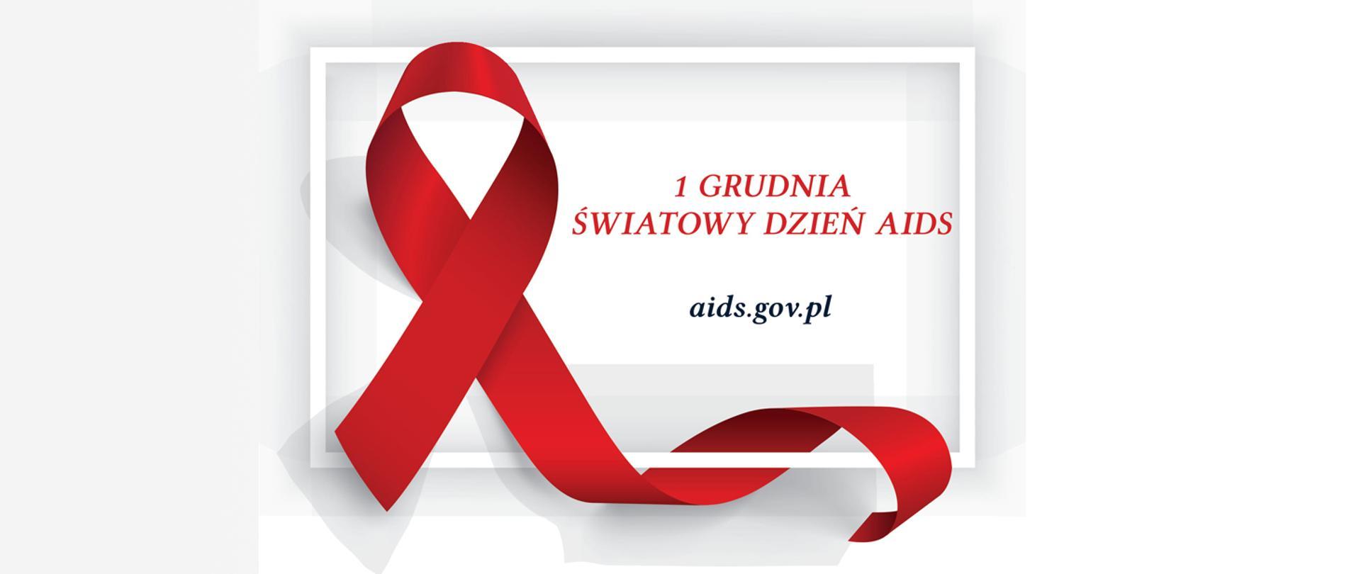 Czerwona wstążeczka - symbol Światowego Dnia AIDS obchodzonego 1 grudnia. Adres strony www: aids.gov.pl